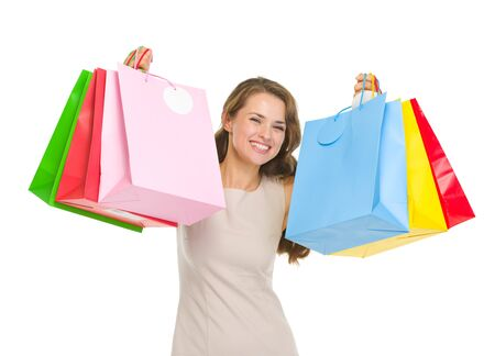 Portrait of happy young woman holding shopping bags Stock Photo - 17382822