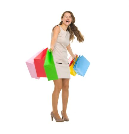 Full length portrait of happy young woman spinning shopping bags Stock Photo - 17382844