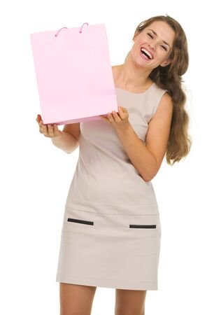 Portrait of happy young woman showing pink shopping bag Stock Photo - 17382855