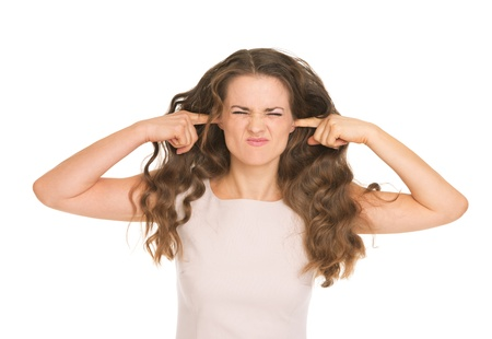 Young woman closing ears Stock Photo - 17382795