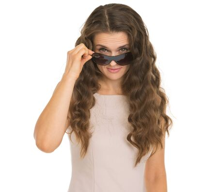 Young woman looking from sunglasses Stock Photo - 17382785