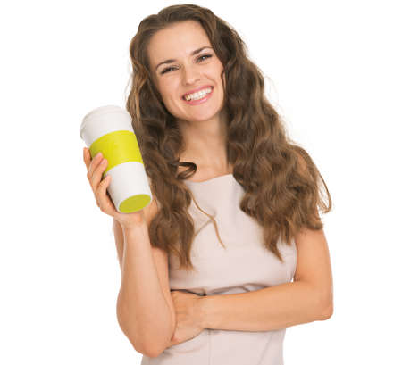 gleeful: Smiling young woman holding coffee cup Stock Photo