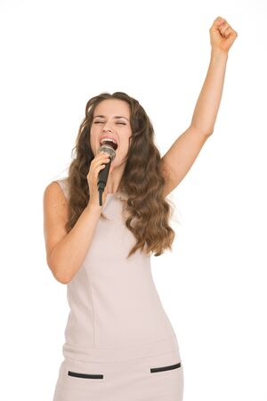 Happy young woman singing with microphone Stock Photo - 17382838