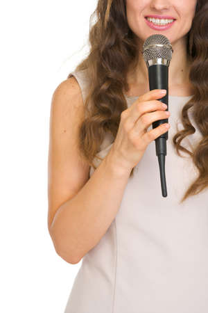 Closeup on young woman with microphone Stock Photo - 17382790