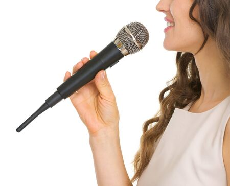 Closeup on young woman with microphone Stock Photo - 17382833