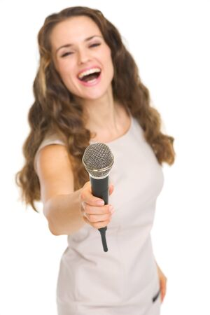 Happy young woman stretching microphone in camera Stock Photo - 17382831