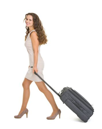 Happy young woman walking with wheels suitcase Stock Photo - 17382854