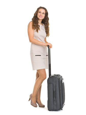 Full length portrait of happy young woman with wheels suitcase Stock Photo - 17382861