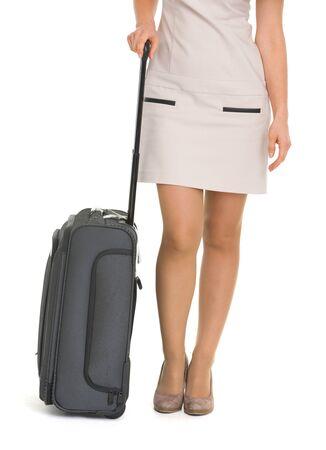 Closeup on wheels suitcase near legs woman Stock Photo - 17388263