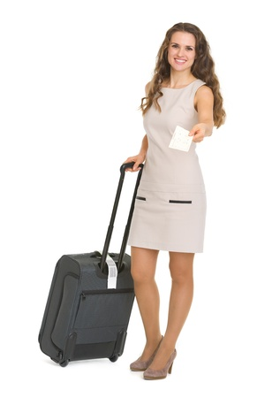 Smiling young woman with wheels suitcase giving air ticket Stock Photo - 17382839