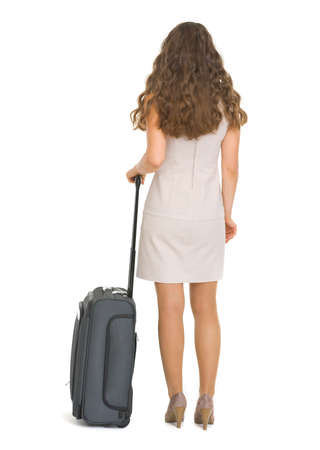 Woman with wheels suitcase. Rear view Stock Photo - 17382827