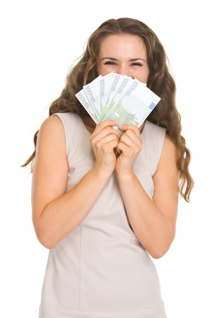 Happy young woman hiding behind fan of euros Stock Photo - 17382797