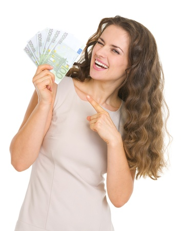 Smiling young woman pointing on euros Stock Photo - 17382789