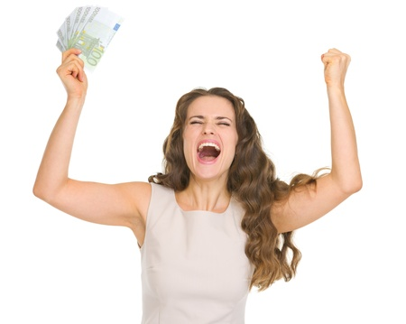 Happy young woman with euro banknotes rejoicing success photo