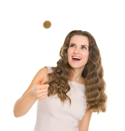 Happy young woman tossing coin Stock Photo - 17423286