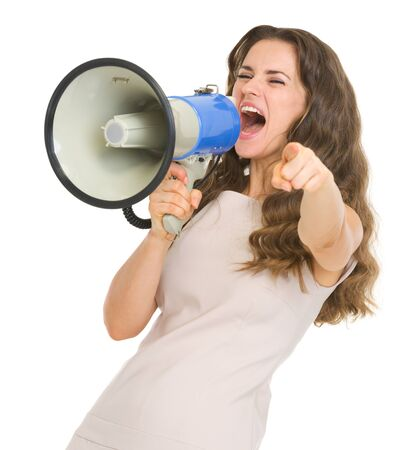 informing: Young woman shouting in megaphone and pointing in camera
