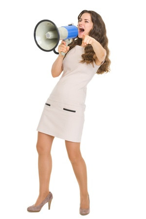 Full length portrait of young woman shouting in megaphone Stock Photo - 17419427