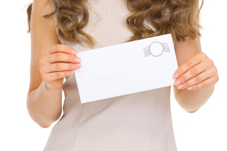 Closeup on envelope in woman hand photo