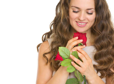 Portrait of young woman with red rose Stock Photo - 17418533