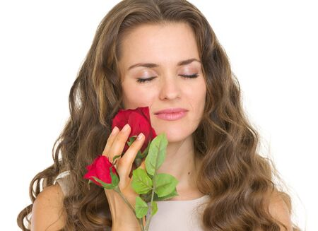 Portrait of young woman enjoying red rose Stock Photo - 17418541