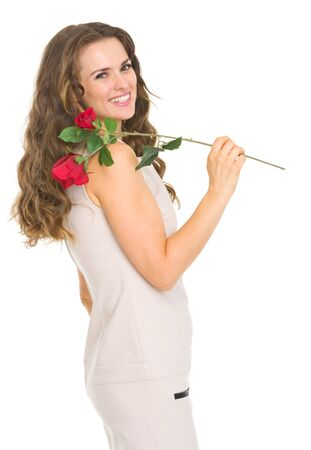 Smiling young woman with red rose Stock Photo - 17418520