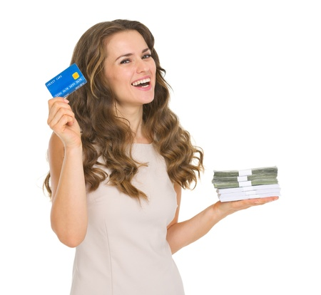 Happy young woman holding credit card and money packs Stock Photo - 17417878