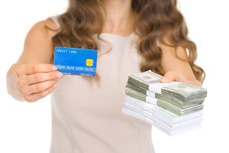 Closeup on woman giving credit card and money packs Stock Photo - 17418509