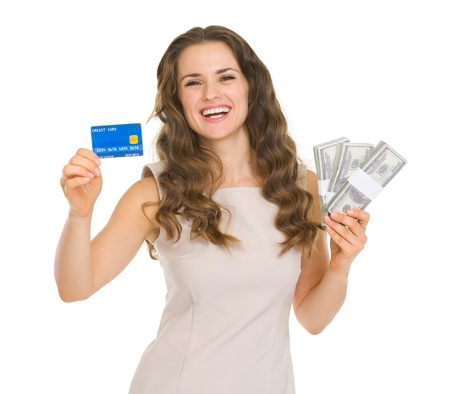 Happy young woman holding credit card and dollars packs Stock Photo - 17417885