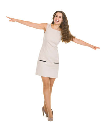 Full length portrait of happy young woman balancing Stock Photo - 17417810