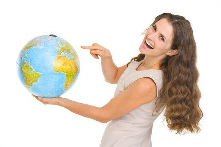 Happy young woman pointing on globe Stock Photo - 17418517