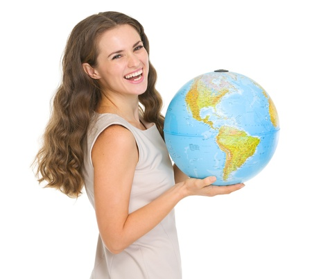 Smiling young woman holding globe Stock Photo - 17417889