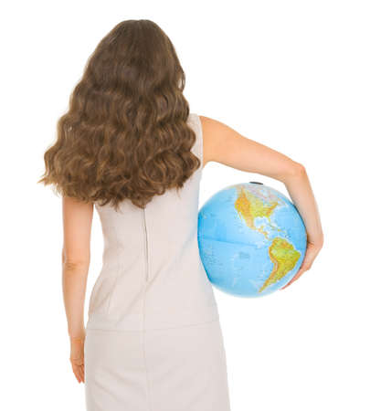 Smiling young woman holding globe. Rear view Stock Photo - 17417828