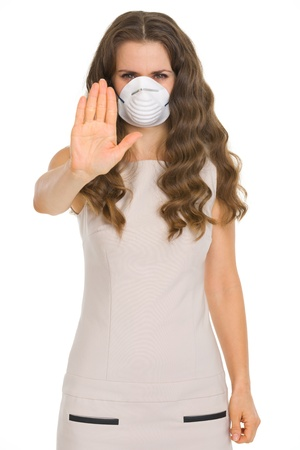 contagion: Young woman in cone mask showing stop gesture