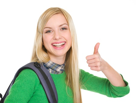 Smiling student girl showing thumbs up Stock Photo - 17418508