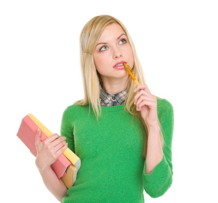 Thoughtful student girl with books Stock Photo - 17418445