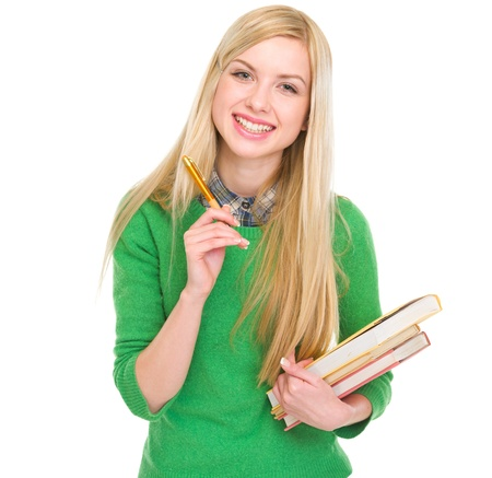 classbook: Smiling student girl with books and pen Stock Photo