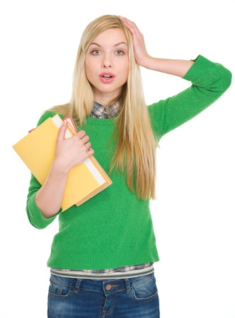 Surprised student girl with books Stock Photo - 17418537