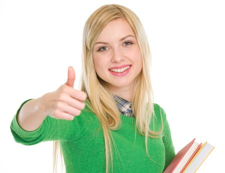 Happy teenage student girl showing thumbs up photo