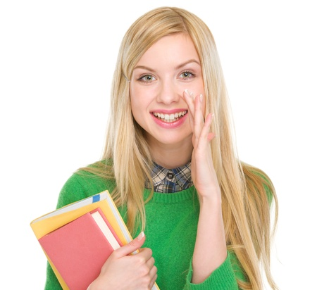 Happy teenage student girl telling good news Stock Photo - 17418506