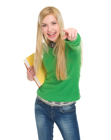 Smiling student girl with books pointing in camera Stock Photo - 17418432