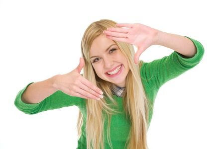 Smiling teenage student girl framing with hands Stock Photo - 17418441
