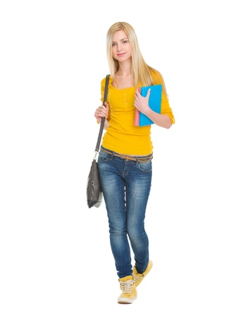 classbook: Teenage student girl with books going forward