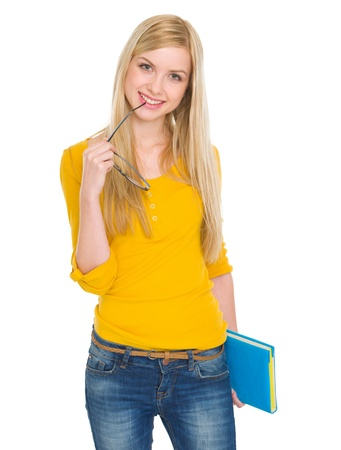 Portrait of happy student girl with book and glasses Stock Photo - 17418431