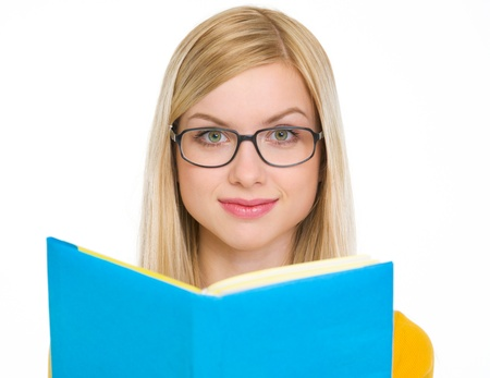youthfulness: Happy student girl reading book in glasses