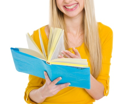Closeup on student girl leaf through book Stock Photo - 17417879
