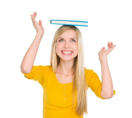 Happy student girl balancing book on head Stock Photo - 17417876