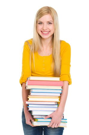 Happy student girl holding pile of books Stock Photo - 17417892