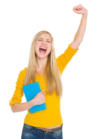 rejoicing: Happy student girl with book rejoicing success