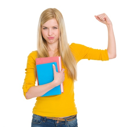 potency: Happy student girl with book showing biceps Stock Photo