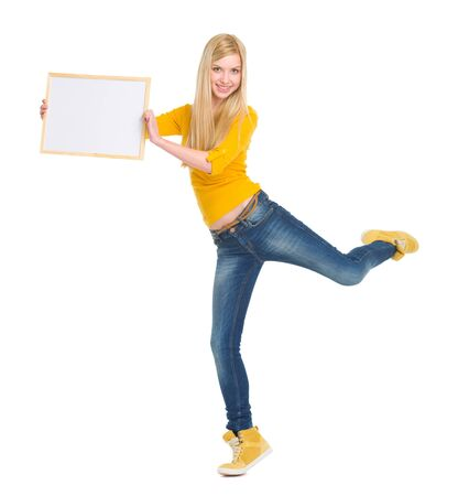 Full length portrait of happy student girl showing blank board Stock Photo - 17417812